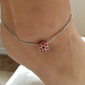 Silver chained anklet with red pendant
